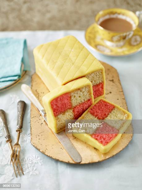 classic battenberg with slices - marzipan stock pictures, royalty-free photos & images