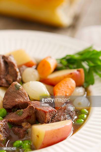 Classic beef stew with potatoes, onions, carrots and peas