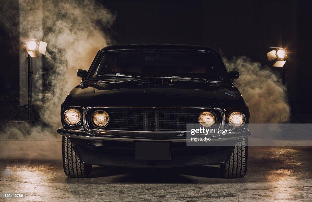 Classic black car in garage : Stock Photo