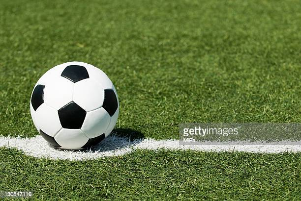 Classic black-and-white football lying on the kick-off point