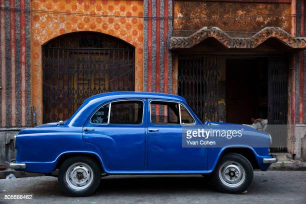 A classic blue Ambassador car parked outside a house in the northern quarter of Kolkata The capital of the Indian state of West Bengal Kolkata is one...