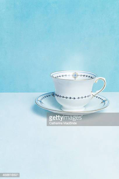 classic blue and white tea cup - catherine macbride stock pictures, royalty-free photos & images