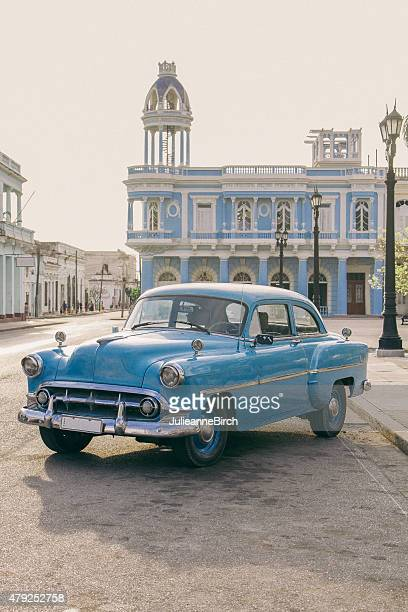 Classic blue car outside Ferrer Palace, Cienfuegos