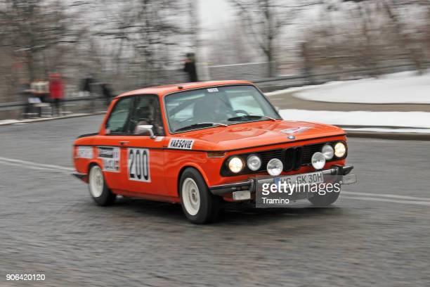 classic bmw 2002 in motion - rally car racing stock pictures, royalty-free photos & images