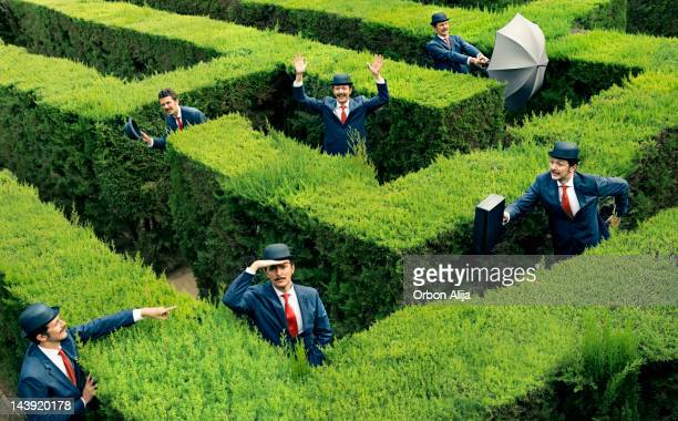 Classic business man looking for the way in a maze