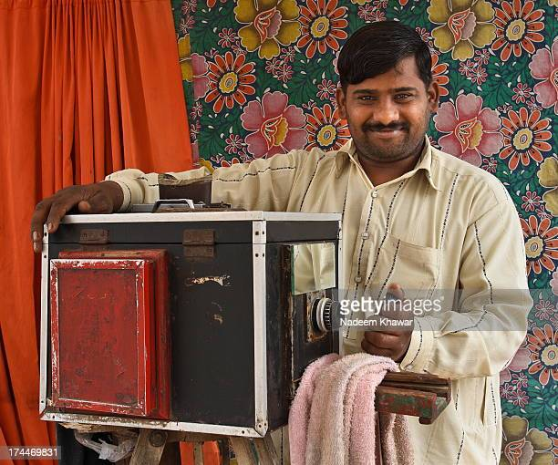 classic camera. - handsome pakistani men stock photos and pictures