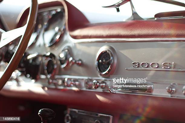 A classic car dashboard during a sunny day