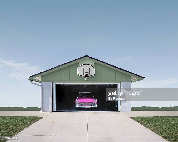 classic car in suburban garage - garage stock pictures, royalty-free photos & images