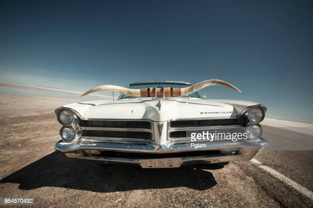 Classic car with horns on the side of the salt flats in Utah USA