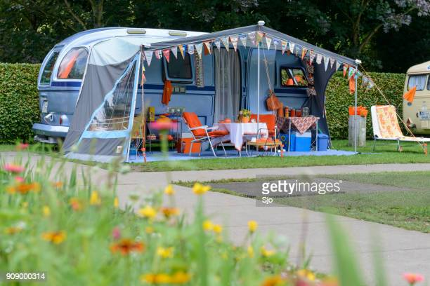 classic caravans camping in a park in vintage style - camper trailer stock pictures, royalty-free photos & images