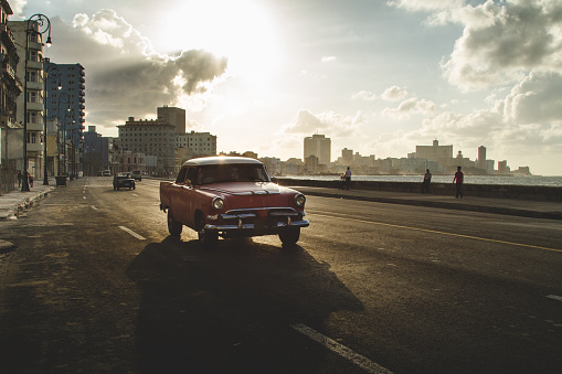 Classic Cars Drive a Havana Malecon Sunset - gettyimageskorea