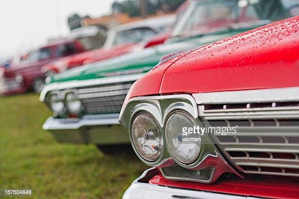 classic cars on parade - hood ornament stock pictures, royalty-free photos & images
