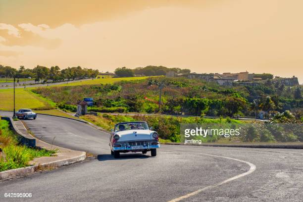 Classic cars on the country road in Cuba