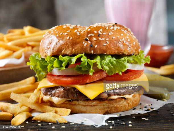 classic cheeseburger on a brioche bun with fries and a milkshake - brioche stock pictures, royalty-free photos & images