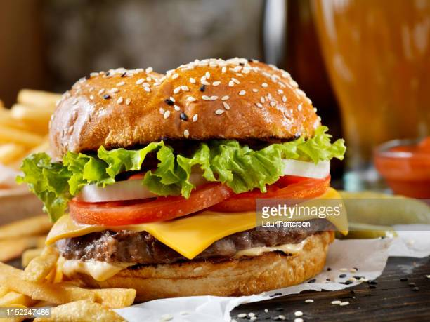 classic cheeseburger on a brioche bun with fries and a milkshake - diner stock pictures, royalty-free photos & images