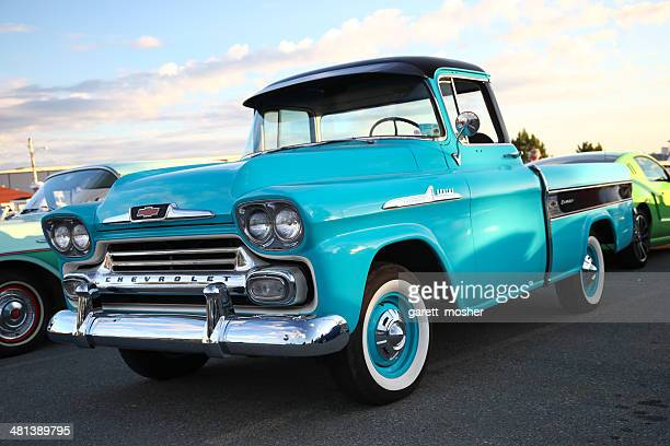 classic chevy truck in parking lot - chevrolet stock pictures, royalty-free photos & images