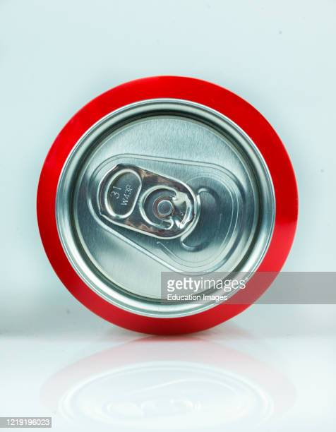 Classic Coke can seen from above with its ring pull, isolated on white.