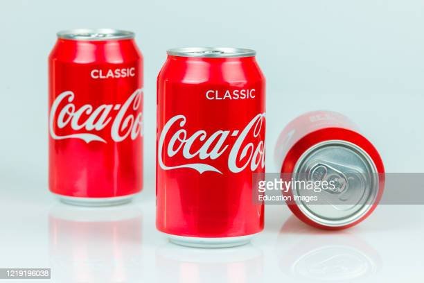Classic Coke cans by Coca Cola isolated on white background.