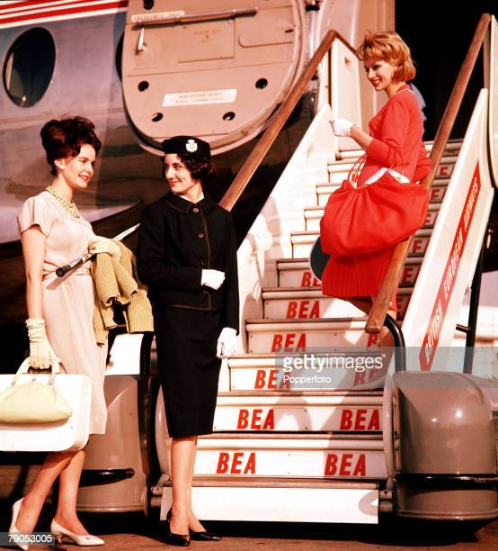 Classic Collection Page 108 A fashion shot of two women walking up a set of steps to an aeroplane with a smiling stewardess 1960