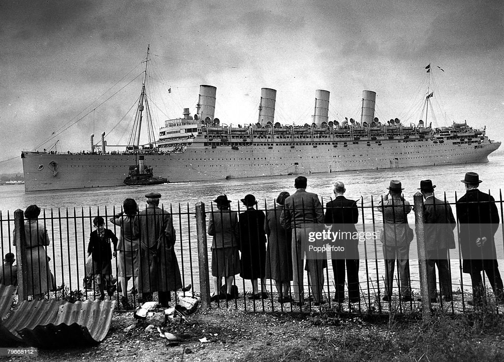 Classic Collection, Page 109, 10414332, The liner 'Aquitania' leaving the docks in Southampton with crowd watching from the shore, carrying 8,000 American troops back to the U,S,A, 9th September 1945 after World War Two