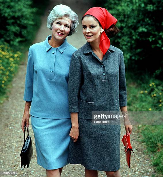 Classic Collection Page 123 Fashion shot of two women in suits walking down a gravel path woman with grey hair in a blue suit other women in red...