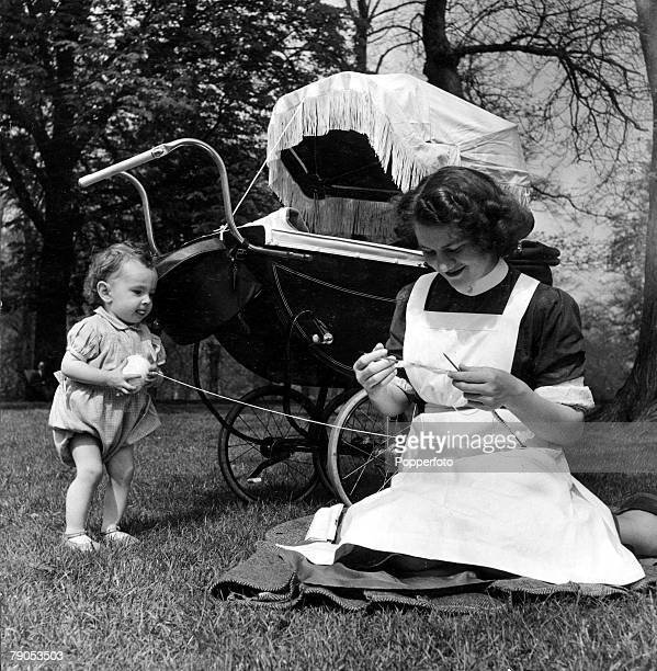 Classic Collection Page 125 Hyde Park London England A nanny sits in the park knitting with a pram in the background and a toddler playing with wool