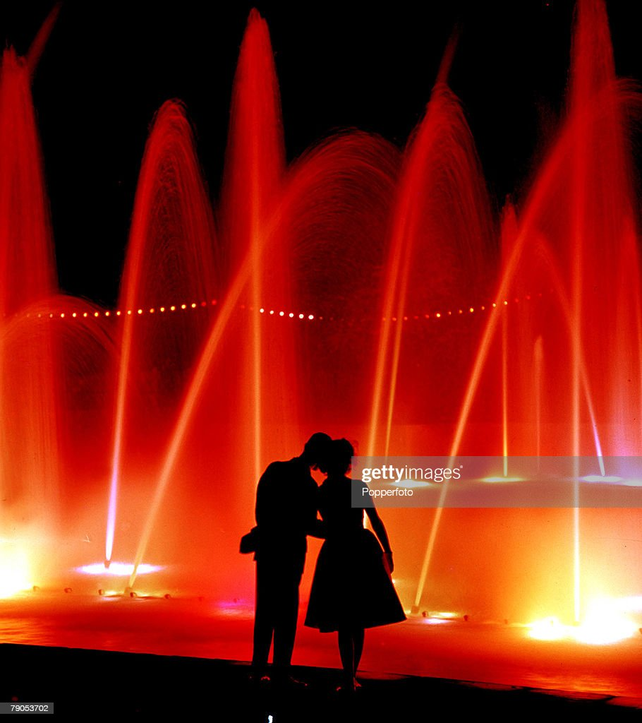 Classic Collection, Page 125, 10422352, Young couple silhouetted against a colourful fountain, at Battersea pleasure gardens, London, 1960