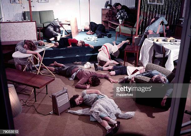 Classic Collection Page 140 A room full of people men women and children lying on the floor and slumped over furniture unconscious seemingly due to...