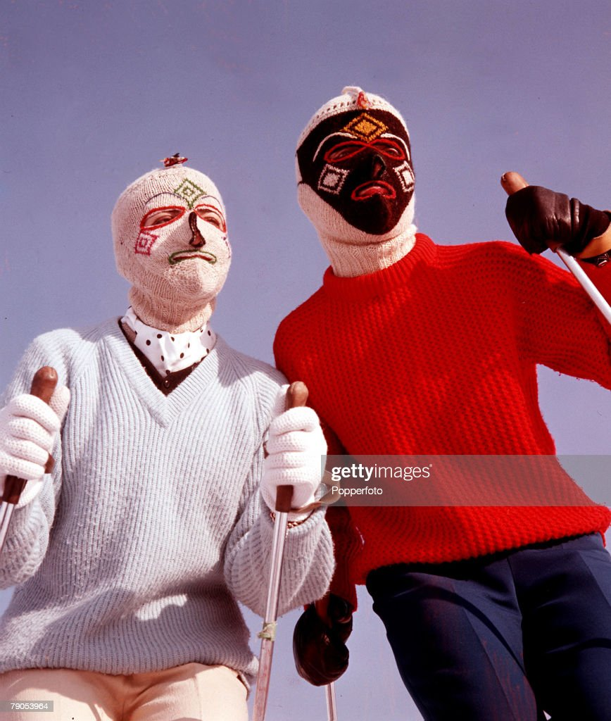 Classic Collection, Page 142, 10432257, Two skiers, in knitted, patterned balaclavas, wearing jumpers and holding ski-poles, 1960
