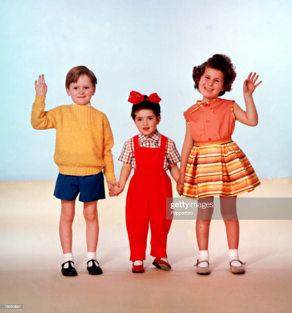 Classic Collection, 10379633, Page 31, 1961, Studio portrait of three children, one boy and two girls waving and holding hands, smiling at the camera