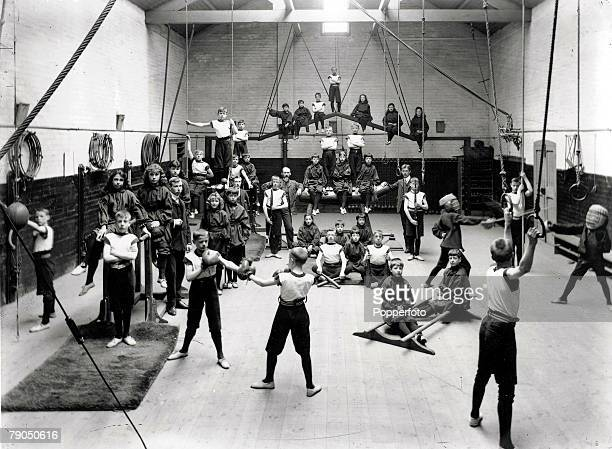 34 Doncaster England A class of school children on apparatus in a large gymnasium during a physical education lesson