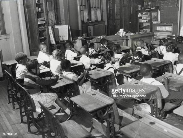 Classic Collection, Page: 36 USA, A classroom of young black pupils sitting at their desks during a lesson in primary school in America