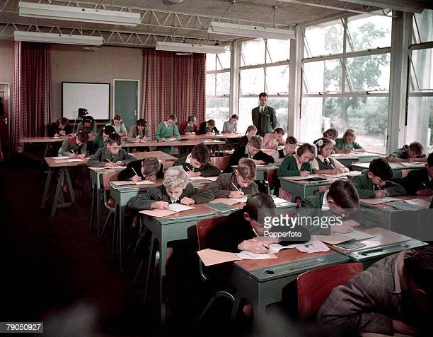 Classic Collection, Page: 37 1949, Britain, Stevenage, Barclay Secondary Modern School, Large classroom full of boys and girls writing at their...