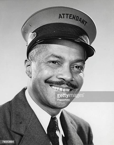 42 12th March A smiling black man with moustache wearing a uniform and attendant's cap