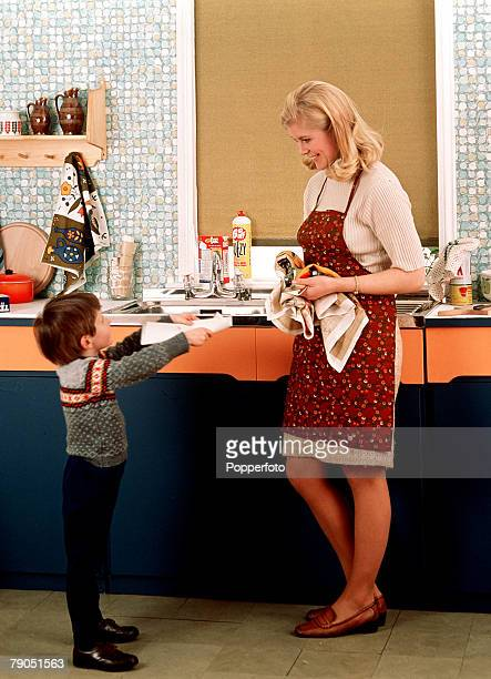 Classic Collection Page 61 1968 Smiling woman in apron in the kitchen with little boy helping