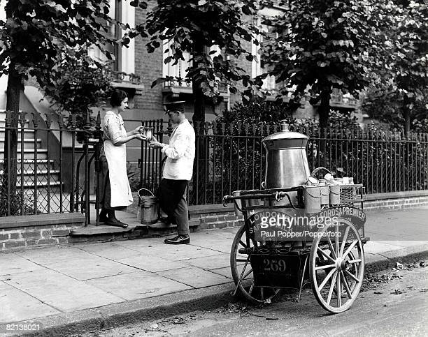 Classic Collection Page 68 London milkman with hand cart and churns selling to woman on steps