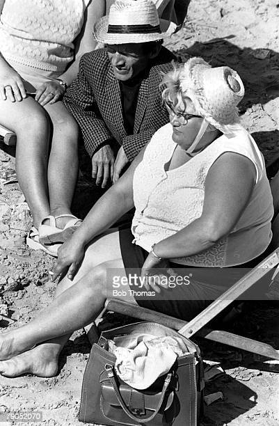 Classic Collection Page 71 Blackpool England A large lady sits in a deckchair on Blackpool beach wearing a straw hat Next to her man in a straw hat a...