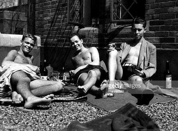 Classic Collection Page 82 Three students at Yale University sun bathing and playing cards Connecticut USA