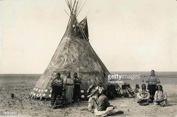 Classic Collection Page 92 Glacier National Park Montana USA A group of American Indians gather around a tepee