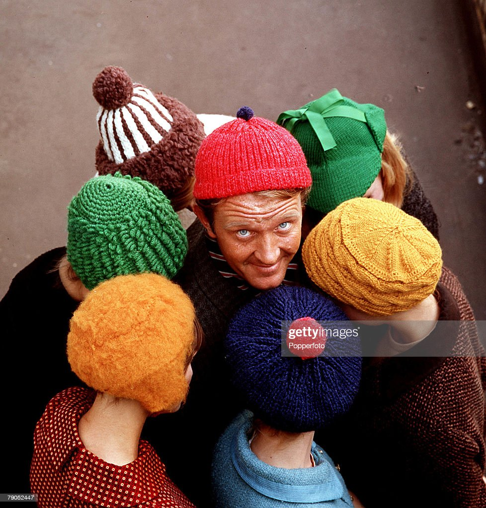 Classic Collection, Page 93, 10407213, 1964, A circle of people in woolly hats, man in centre wearing a red hat, looking up at the camera, the rest of the people looking down