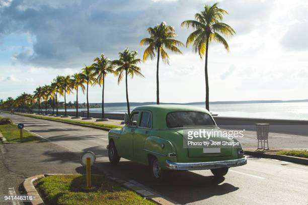 classic cuba vintage car driving - vintage car stock pictures, royalty-free photos & images