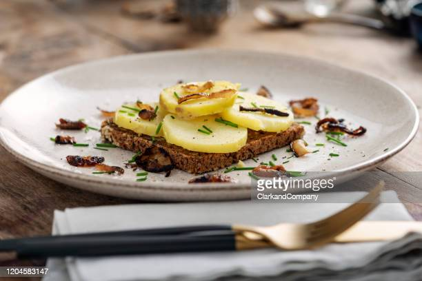 classic danish smorrebrod potato sandwich. - danish culture stock pictures, royalty-free photos & images