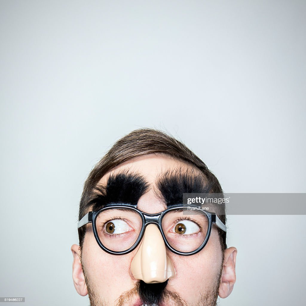Classic Disguise Glasses on Man : Stock Photo