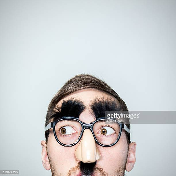 classic disguise glasses on man - groucho marx stock photos and pictures