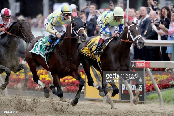 Classic Empire with jockey Julien Leparoux aboard and Always Dreaming with John Velazquez up head into the first turn during the 142nd Preakness...