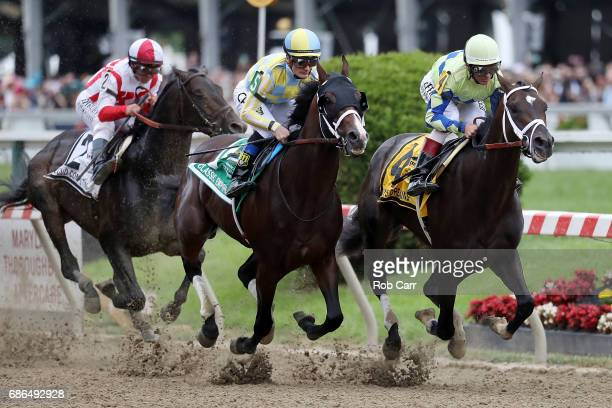 Classic Empire with jockey Julien Leparoux aboard and Always Dreaming with John Velazquez up head into the first turn as Cloud Computing and Javier...