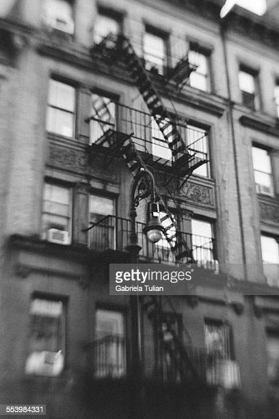 classic facade of old building in nyc - black and white instant print stock pictures, royalty-free photos & images