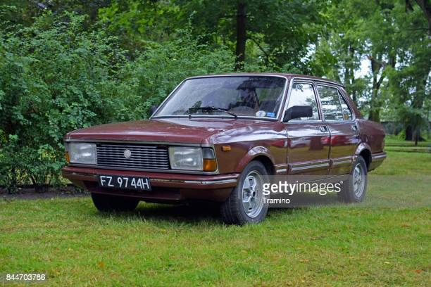 classic fiat argenta on the grass - sedan stock pictures, royalty-free photos & images