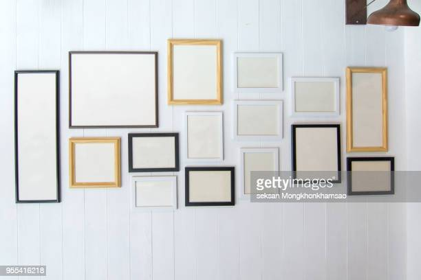 classic frame on white cement wall in showroom and gallery. - art gallery stock pictures, royalty-free photos & images