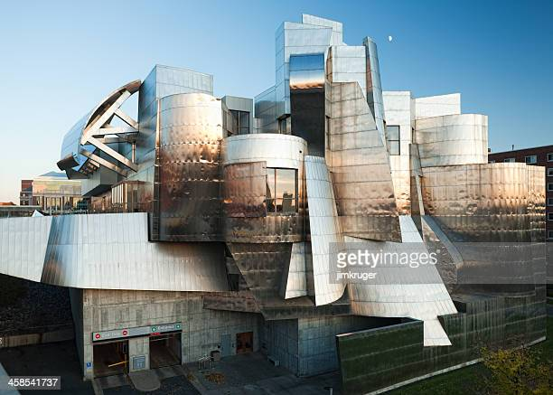 classic frank gehry stainless steel facade. - frank gehry stock photos and pictures